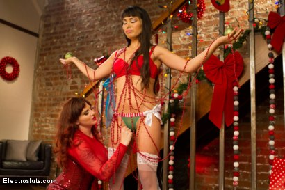 Photo number 3 from An Electrosluts Christmas with Mz Berlin shot for Electro Sluts on Kink.com. Featuring Mz Berlin and Milcah Halili in hardcore BDSM & Fetish porn.