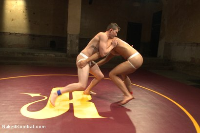 """Photo number 3 from Will """"The Punisher"""" Parks vs Conrad """"The Conqueror"""" Logun shot for Naked Kombat on Kink.com. Featuring Conrad Logun and Will Parks in hardcore BDSM & Fetish porn."""