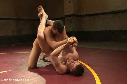 """Photo number 8 from Will """"The Punisher"""" Parks vs Conrad """"The Conqueror"""" Logun shot for Naked Kombat on Kink.com. Featuring Conrad Logun and Will Parks in hardcore BDSM & Fetish porn."""