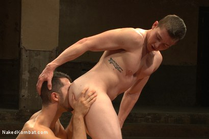 """Photo number 11 from Will """"The Punisher"""" Parks vs Conrad """"The Conqueror"""" Logun shot for Naked Kombat on Kink.com. Featuring Conrad Logun and Will Parks in hardcore BDSM & Fetish porn."""