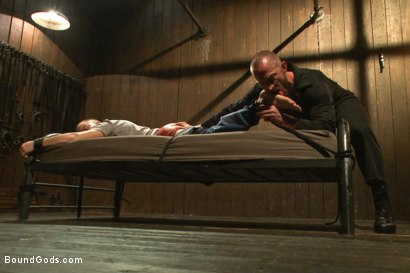 Photo number 2 from Helpless stud's torturous ordeal at the hands of a twisted pervert  shot for Bound Gods on Kink.com. Featuring Adam Herst and Eli Hunter in hardcore BDSM & Fetish porn.