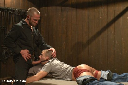 Photo number 3 from Helpless stud's torturous ordeal at the hands of a twisted pervert  shot for Bound Gods on Kink.com. Featuring Adam Herst and Eli Hunter in hardcore BDSM & Fetish porn.