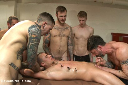Photo number 13 from Horny crowd mercilessly gang fucks a bound hung stud against his will  shot for Bound in Public on Kink.com. Featuring Eli Hunter, Mitch Vaughn and Christian Wilde in hardcore BDSM & Fetish porn.
