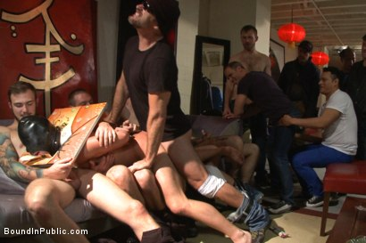 Photo number 4 from Horny crowd mercilessly gang fucks a bound hung stud against his will  shot for Bound in Public on Kink.com. Featuring Eli Hunter, Mitch Vaughn and Christian Wilde in hardcore BDSM & Fetish porn.
