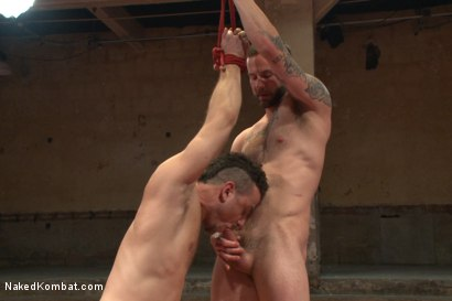 """Photo number 14 from Leon """"The Masticator"""" Fox vs Chris """"Mr Bad-Ass"""" Bines shot for Naked Kombat on Kink.com. Featuring Chris Bines and Leon Fox in hardcore BDSM & Fetish porn."""