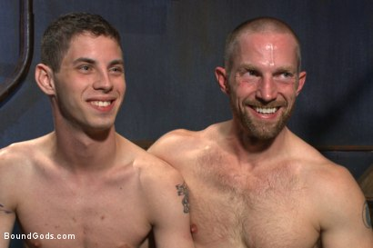 """Photo number 15 from """"Boy, it's not a costume... it's leather!"""" shot for Bound Gods on Kink.com. Featuring Adam Herst and Sam Truitt in hardcore BDSM & Fetish porn."""