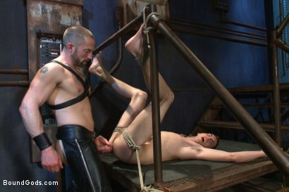 "Photo number 13 from ""Boy, it's not a costume... it's leather!"" shot for Bound Gods on Kink.com. Featuring Adam Herst and Sam Truitt in hardcore BDSM & Fetish porn."