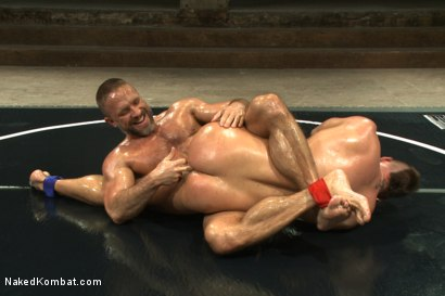 """Photo number 1 from Jesse """"Cut-Throat"""" Colter vs Dirk """"The Claymore"""" Caber shot for Naked Kombat on Kink.com. Featuring Jessie Colter and Dirk Caber in hardcore BDSM & Fetish porn."""