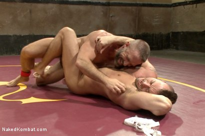 """Photo number 10 from Jesse """"Cut-Throat"""" Colter vs Dirk """"The Claymore"""" Caber shot for Naked Kombat on Kink.com. Featuring Jessie Colter and Dirk Caber in hardcore BDSM & Fetish porn."""