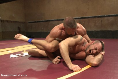 """Photo number 13 from Jesse """"Cut-Throat"""" Colter vs Dirk """"The Claymore"""" Caber shot for Naked Kombat on Kink.com. Featuring Jessie Colter and Dirk Caber in hardcore BDSM & Fetish porn."""