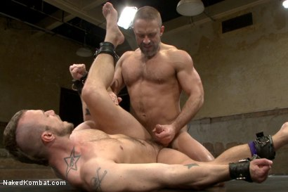 """Photo number 8 from Jesse """"Cut-Throat"""" Colter vs Dirk """"The Claymore"""" Caber shot for Naked Kombat on Kink.com. Featuring Jessie Colter and Dirk Caber in hardcore BDSM & Fetish porn."""