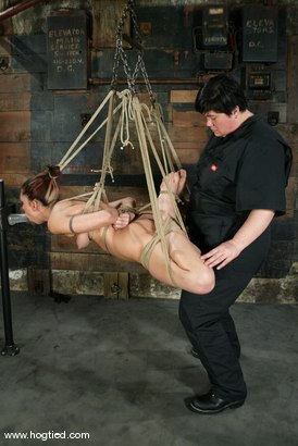 Photo number 4 from Satine Phoenix and Sir C shot for Hogtied on Kink.com. Featuring Sir C and Satine Phoenix in hardcore BDSM & Fetish porn.