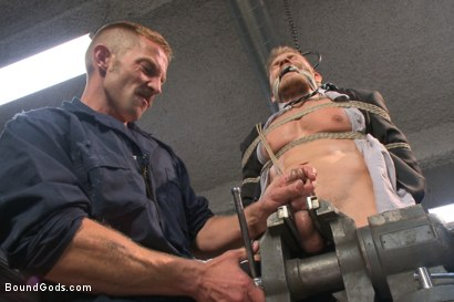 Photo number 6 from Cocky businessman bound and fucked in the metal shop shot for Bound Gods on Kink.com. Featuring Alex Adams and Adam Herst in hardcore BDSM & Fetish porn.