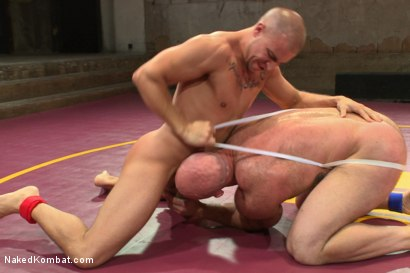 "Photo number 2 from Hot muscled newbie Tatum ""The Beast"" takes on Eli ""The Hammer"" Hunter shot for Naked Kombat on Kink.com. Featuring Eli Hunter and Tatum in hardcore BDSM & Fetish porn."