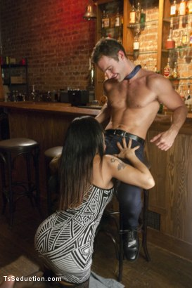 Photo number 2 from Tell Mama - Bartender Seduces Sad Sack Patron with Her Hard Cock!! shot for TS Seduction on Kink.com. Featuring TS Foxxy and Cameron Kincade in hardcore BDSM & Fetish porn.
