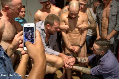 Photo number 14 from Bar Slut Gang Fucked and Covered in the Crowd's Cum  shot for Bound in Public on Kink.com. Featuring Christian Wilde, Dylan Strokes and Corbin Dallas in hardcore BDSM & Fetish porn.