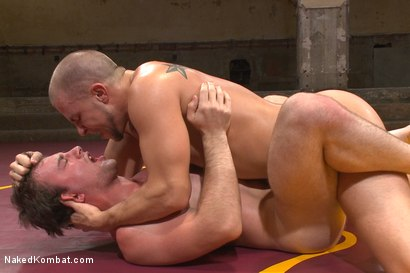Gay wrestlers pound each other hard after a match in