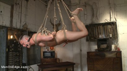 Photo number 14 from Smug techie gets taught a lesson while relentlessly edged in mid-air shot for Men On Edge on Kink.com. Featuring Derek Scott in hardcore BDSM & Fetish porn.