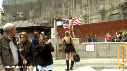 Photo number 11 from Slutty American Tourist Publicly Disgraces Herself!!! shot for Public Disgrace on Kink.com. Featuring Mona Wales, Juliette March and Xavi Tralla in hardcore BDSM & Fetish porn.