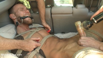 Photo number 6 from Ripped stud with a big cock carjacked and edged in the wilderness shot for Men On Edge on Kink.com. Featuring Damien Michaels in hardcore BDSM & Fetish porn.