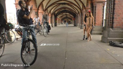 Photo number 7 from Filthy Lullu Gun Gets Fully Naked and Barefoot on Dirty Streets shot for Public Disgrace on Kink.com. Featuring Juliette March, Jason Steel, Lullu Gun  and Steve Holmes in hardcore BDSM & Fetish porn.