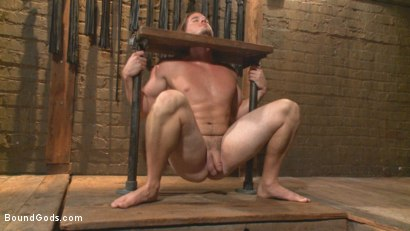 Photo number 5 from Guy next door held in a stock, facefucked and flogged shot for Bound Gods on Kink.com. Featuring Kip Johnson and Christian Wilde in hardcore BDSM & Fetish porn.