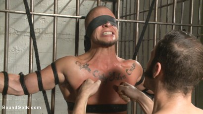 Photo number 8 from Arrogant Cop Tormented by His Prisoner  shot for Bound Gods on Kink.com. Featuring Wolf Hudson and Eli Hunter in hardcore BDSM & Fetish porn.