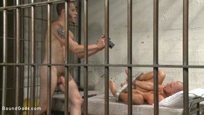 Photo number 14 from Arrogant Cop Tormented by His Prisoner  shot for Bound Gods on Kink.com. Featuring Wolf Hudson and Eli Hunter in hardcore BDSM & Fetish porn.