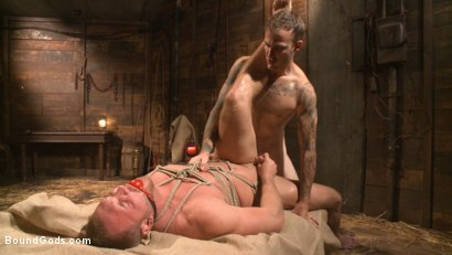Photo number 12 from Farmboy punished for jerking off on the job shot for Bound Gods on Kink.com. Featuring Christian Wilde and Josh Peters in hardcore BDSM & Fetish porn.
