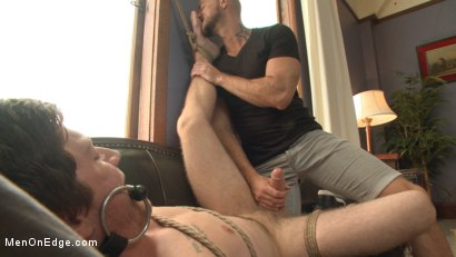 Photo number 12 from First time getting edged for a big fat cock! shot for Men On Edge on Kink.com. Featuring Logan Taylor in hardcore BDSM & Fetish porn.