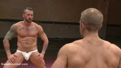 Photo number 2 from Muscle Matchup - Dirk Caber vs Hugh Hunter shot for Naked Kombat on Kink.com. Featuring Dirk Caber and Hugh Hunter in hardcore BDSM & Fetish porn.