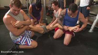 Photo number 1 from Connor Maguire's Gym Slave Takes on a Weight Room Full of Cocks shot for Bound in Public on Kink.com. Featuring Connor Maguire, Aarin Asker and Logan Taylor in hardcore BDSM & Fetish porn.