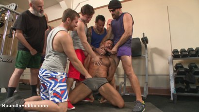 Photo number 3 from Connor Maguire's Gym Slave Takes on a Weight Room Full of Cocks shot for Bound in Public on Kink.com. Featuring Connor Maguire, Aarin Asker and Logan Taylor in hardcore BDSM & Fetish porn.