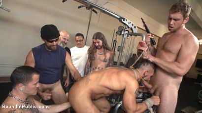 Photo number 2 from Horny gym goers dump their loads on a muscled gym rat shot for Bound in Public on Kink.com. Featuring Connor Maguire, Aarin Asker and Logan Taylor in hardcore BDSM & Fetish porn.