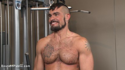 Photo number 15 from Horny gym goers dump their loads on a muscled gym rat shot for Bound in Public on Kink.com. Featuring Connor Maguire, Aarin Asker and Logan Taylor in hardcore BDSM & Fetish porn.