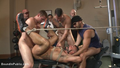 Photo number 11 from Horny gym goers dump their loads on a muscled gym rat shot for Bound in Public on Kink.com. Featuring Connor Maguire, Aarin Asker and Logan Taylor in hardcore BDSM & Fetish porn.