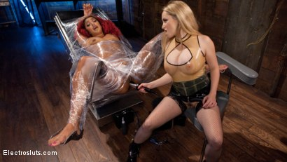 Photo number 4 from The Squirt Collector: Daisy Ducati squirts for science! shot for Electro Sluts on Kink.com. Featuring Daisy Ducati and Aiden Starr in hardcore BDSM & Fetish porn.