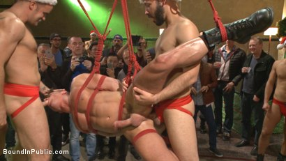 Photo number 13 from Muscled submissive whored out by santa for the holidays shot for Bound in Public on Kink.com. Featuring Rex Cameron, Vinnie Stefano and Connor Maguire in hardcore BDSM & Fetish porn.