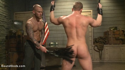 Photo number 8 from Enhanced Interrogation: Detained Stud Faces a Horny, Sadistic Agent shot for Bound Gods on Kink.com. Featuring Tommy Regan and Damien Michaels in hardcore BDSM & Fetish porn.
