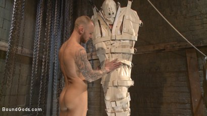 Photo number 6 from Enhanced Interrogation: Detained Stud Faces a Horny, Sadistic Agent shot for Bound Gods on Kink.com. Featuring Tommy Regan and Damien Michaels in hardcore BDSM & Fetish porn.