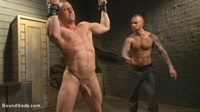 Photo number 2 from Enhanced Interrogation: Detained Stud Faces a Horny, Sadistic Agent shot for Bound Gods on Kink.com. Featuring Tommy Regan and Damien Michaels in hardcore BDSM & Fetish porn.