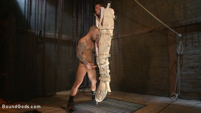 Photo number 11 from Enhanced Interrogation: Detained Stud Faces a Horny, Sadistic Agent shot for Bound Gods on Kink.com. Featuring Tommy Regan and Damien Michaels in hardcore BDSM & Fetish porn.