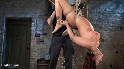 Photo number 1 from Pain Slut Suffers with a Smile in Brutal Bondage shot for hogtied on Kink.com. Featuring Holly Heart and The Pope in hardcore BDSM & Fetish porn.
