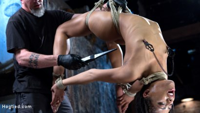 Photo number 9 from All Natural Ebony Newcomer in Brutal Bondage and Suffering Like a Pro! shot for Hogtied on Kink.com. Featuring Kira Noir and The Pope in hardcore BDSM & Fetish porn.