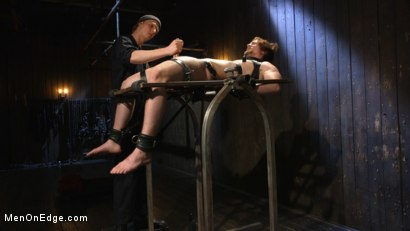 Photo number 11 from Metal Rack to Sleep Sack: Captive Boy's Thick Cock Edged Mercilessly shot for Men On Edge on Kink.com. Featuring Scotty Zee in hardcore BDSM & Fetish porn.