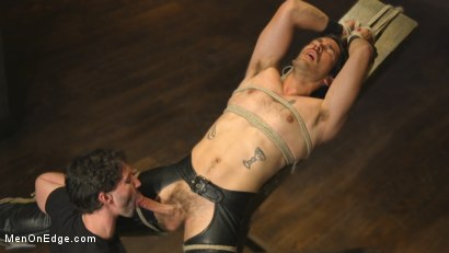 Hot leather stud with a fat cock gets edged