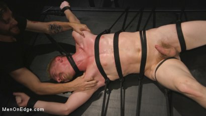 Photo number 14 from Uncut Stud Edged Beyond His Limit in Stocks shot for Men On Edge on Kink.com. Featuring Cody Winter in hardcore BDSM & Fetish porn.