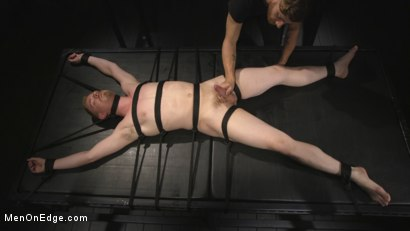Photo number 12 from Uncut Stud Edged Beyond His Limit in Stocks shot for Men On Edge on Kink.com. Featuring Cody Winter in hardcore BDSM & Fetish porn.