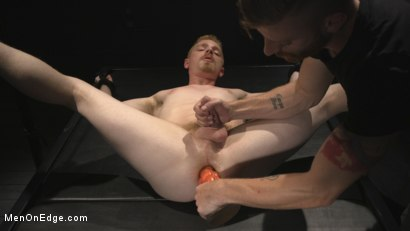 Photo number 9 from Uncut Stud Edged Beyond His Limit in Stocks shot for Men On Edge on Kink.com. Featuring Cody Winter in hardcore BDSM & Fetish porn.