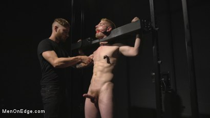 Photo number 4 from Uncut Stud Edged Beyond His Limit in Stocks shot for Men On Edge on Kink.com. Featuring Cody Winter in hardcore BDSM & Fetish porn.